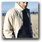 Samuel On The Beach In An Overcoat